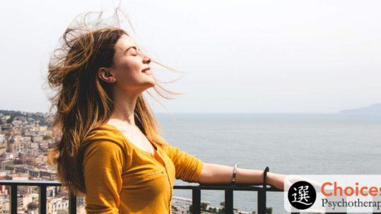 Binge eating disorder, personal stories, happy woman in breeze