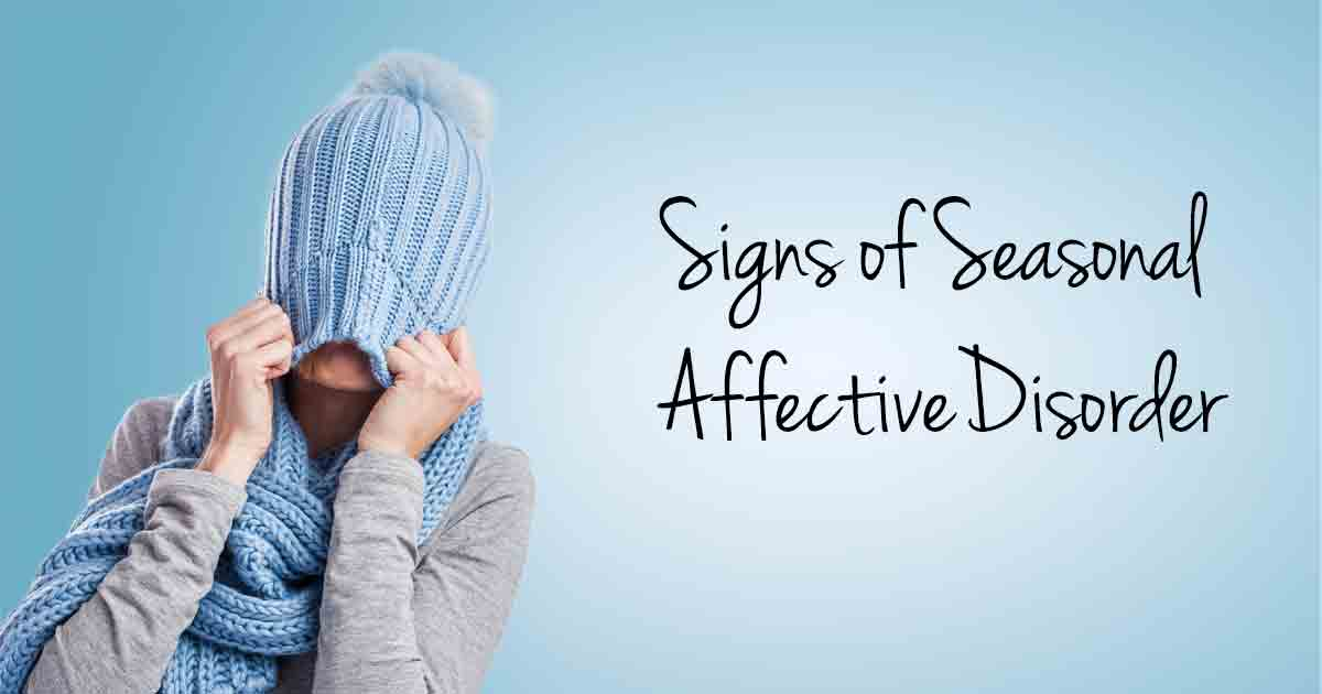 Signs of Seasonal Affective Disorder, woman with winter hat pulled down over eyes