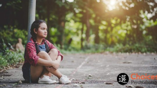 Tips to Avoid A Back-To-School Autism Meltdown, Girl sitting on pavement