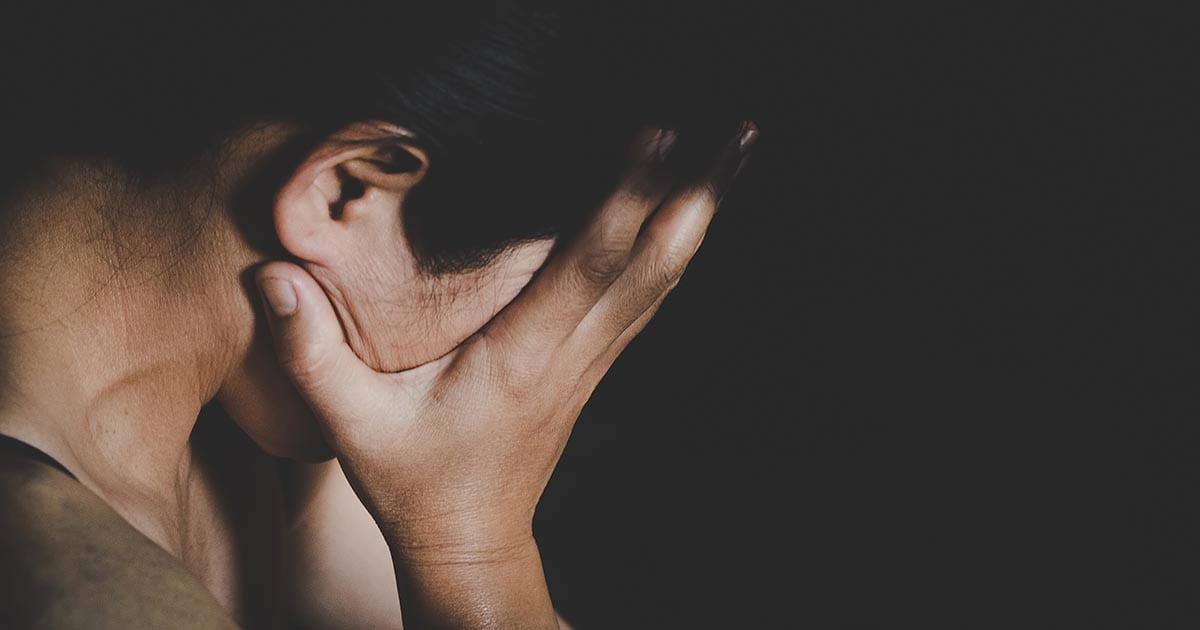 Myth vs. Truth: Rape and Sexual Trauma, sad girl sitting in field